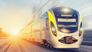 Modern high speed train on a clear day with moti­on blur